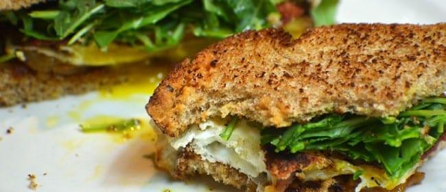 Caramelized Onion, Arugula, Bacon & Egg Sandwich